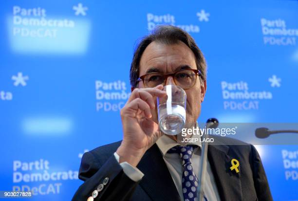 Former President of the Catalan regional government and leader of 'Partit Democrata Europeu Catala' PDECAT Artur Mas drinks water as he holds a press...