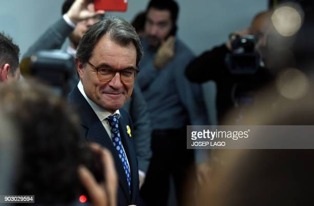 Former President of the Catalan regional government and leader of 'Partit Democrata Europeu Catala' PDECAT Artur Mas leaves after holding a press...