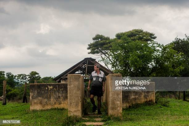 Former president of the Commercial Farmers Union Deon Theron inspects a disused cattle dip on Eden farm, on November 27, 2017 in Beatrice, Zimbabwe,...