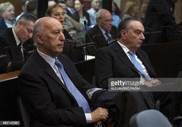 Former president of the Delegation of Argentine Jewish Associations Ruben Beraja and former Federal Police captain Jorge 'Fino' Palacios attend the...