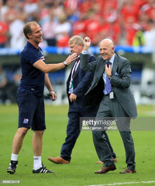 Former president of the Football Association of Iceland Eggert Magnusson celebrates on the pitch after the final whistle