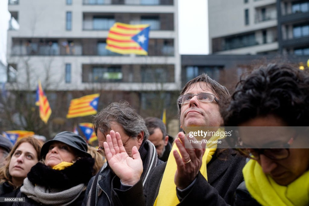 Former President of the Generalitat of Catalonia Artur Mas (L), Ousted Catalan leader Carles Puigdemont (C) and the General Secretary of the Republican Left of Catalonia Marta Rovira Verges (R) are listening to speeches during a pro-Catalan supporters during a demonstration in the EU quarter. Thousands of Catalonian people protest for the Independence of Catalonia.