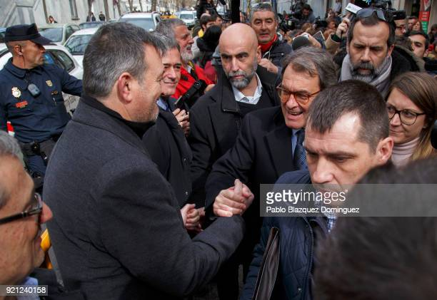 Former President of the Generalitat of Catalonia Artur Mas shake hands with supporters as he leaves the Supreme Court on February 20 2018 in Madrid...