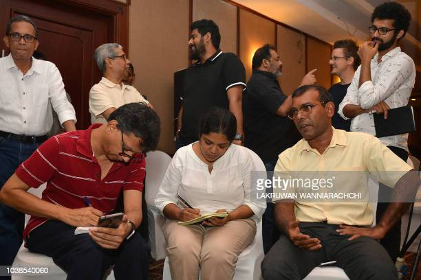 Former President of the Maldives Mohamed Nasheed answers to journalists at a hotel in Colombo on September 23 2018 as his candidate Ibrahim Mohamed...