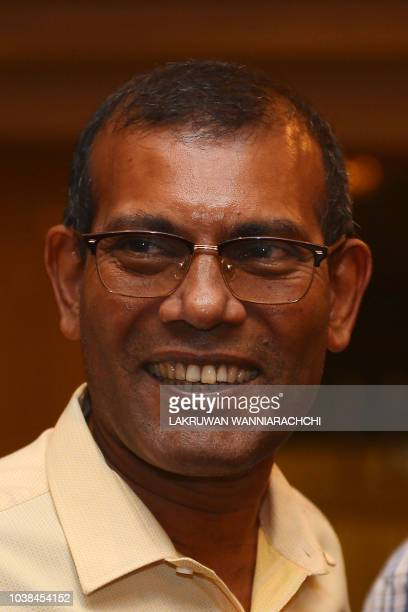Former President of the Maldives Mohamed Nasheed smiles at a hotel in Colombo on September 23 2018 as his candidate Ibrahim Mohamed Solih was set to...