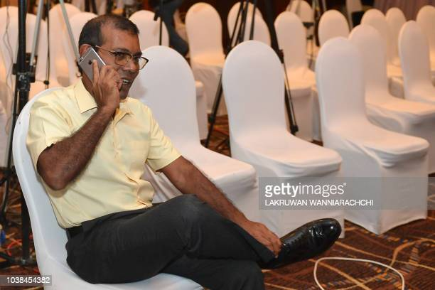 Former President of the Maldives Mohamed Nasheed speaks on the phone at a hotel in Colombo on September 23 2018 as his candidate Ibrahim Mohamed...