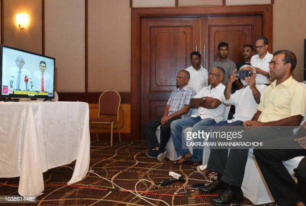 Former President of the Maldives Mohamed Nasheed watches a speech by Maldivian presidential candidate Ibrahim Mohamed Solih on TV at a hotel in...