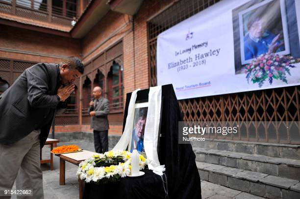 Former president of the Nepal Mountaineering Association Ang Tshering Sherpa offering flower towards poster of Legendary Elizabeth Hawley during the...