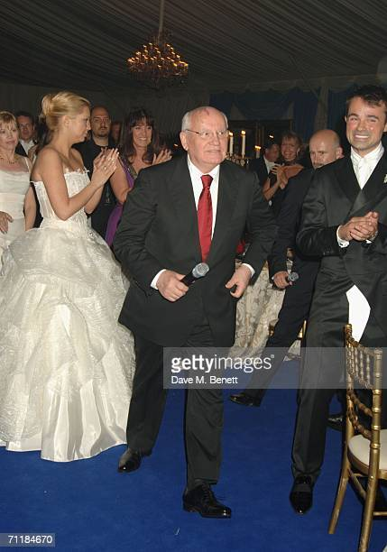 Former President of the Soviet Union Mikhail Gorbachev walks to the stage as his grand-daughter Ksenia Virganskaya and President of the Raisa...