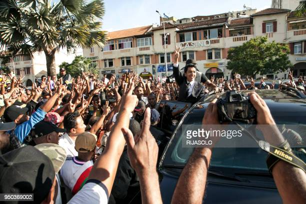 TOPSHOT Former President of the Transition Andry Rajoelina waves to opposition supporters and deputies as they gather at 'May 13 Square' in...