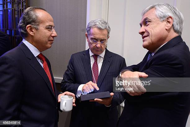 Former President of the United Mexican States Felipe Calderon Former President of the Republic of Colombia Alvaro Uribe Velez and Former President of...