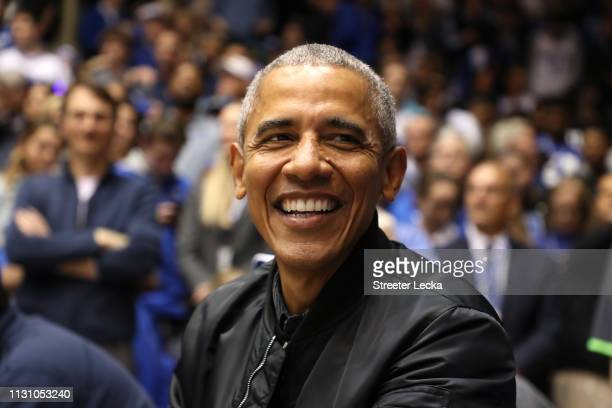 Former President of the United States Barack Obama watches on during the game between the North Carolina Tar Heels and Duke Blue Devils at Cameron...