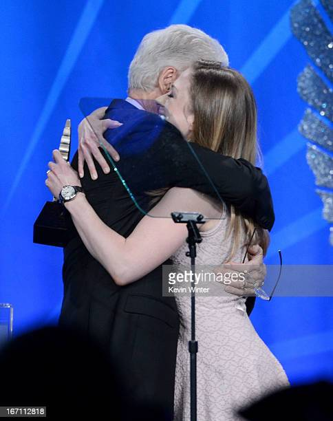 Former President of the United States Bill Clinton accepts the Advocate for Change Award with Chelsea Clinton onstage during the 24th Annual GLAAD...