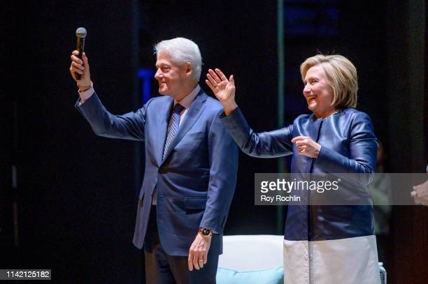 Former President of the United States Bill Clinton with his wife Former Secretary of State and presidential candidate Hillary Clinton on Stage during...