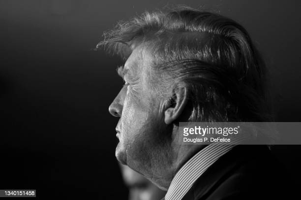 Former President of the United States Donald Trump looks on prior to the fight between Evander Holyfield and Vitor Belfort during Evander Holyfield...
