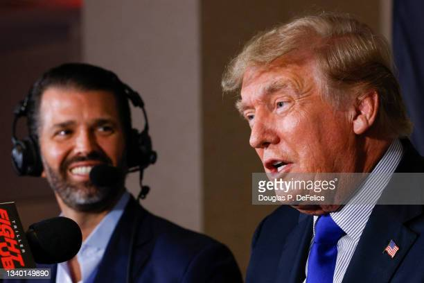Former President of the United States Donald Trump speaks as Donald Trump Jr. Looks on prior to the fight between Evander Holyfield and Vitor Belfort...