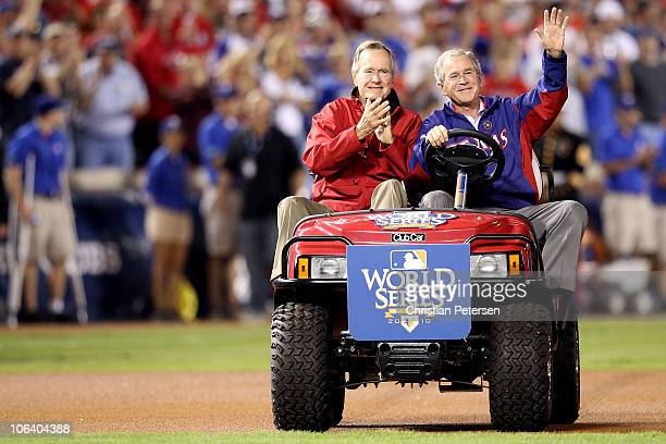 Former President of the United States George W Bush and his father Former President George HW Bush waves to the crowd before the Texas Rangers host...