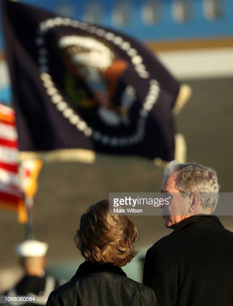 Former President of the United States George W Bush stands with Former First Lady of the United States Laura Bush after the arrival of US Air Force...