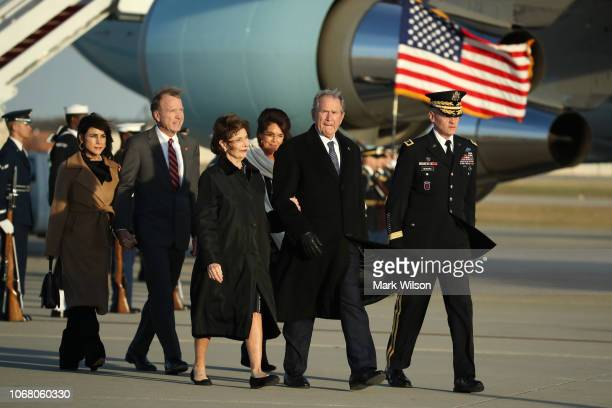 Former President of the United States George W Bush walks with Former First Lady of the United States Laura Bush after the arrival of US Air Force...