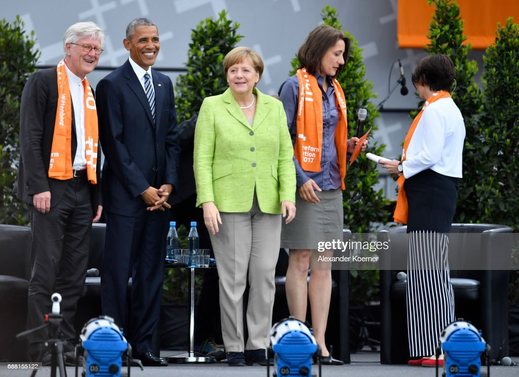 Former President of the United States of America, Barack Obama (2nd L) and German Chancellor Angela Merkel (CDU) (3rd L) walk on stage at the Brandenburg Gate during the nationwide church congress on May 25, 2017 in Berlin, Germany. The church day will be held from May 24th to 28th and celebrates its 500 anniversary of the Reformation.