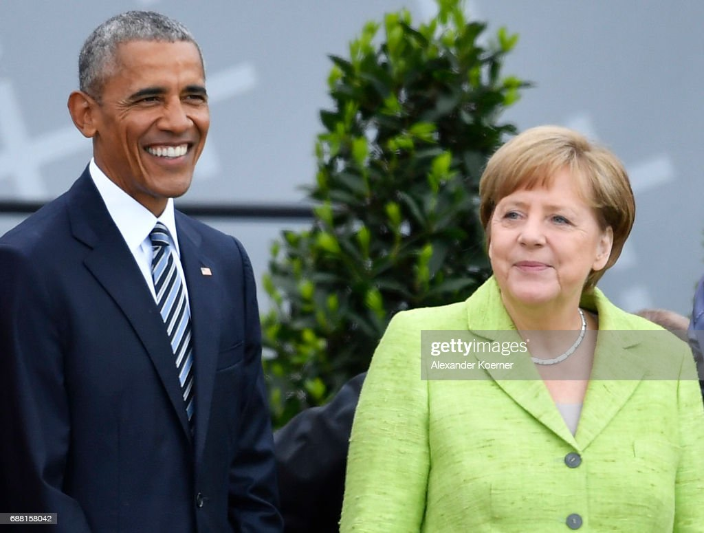 Former President of the United States of America, Barack Obama and German Chancellor Angela Merkel (CDU) walk on stage at the Brandenburg Gate during the nationwide Church Congress on May 25, 2017 in Berlin, Germany. Up to 200,000 faithful are expected to attend the five-day congress in Berlin and Wittenberg which is celebrating the 500th anniversary of the Reformation.