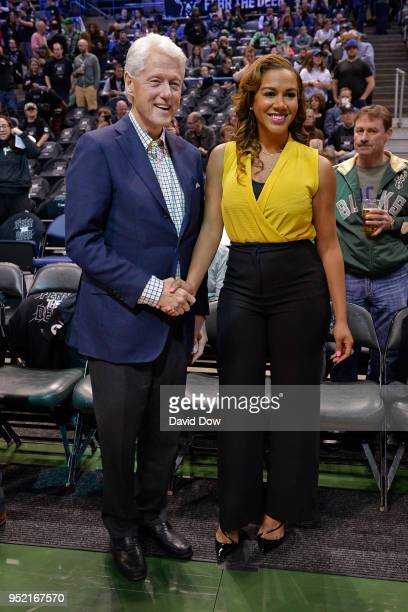 Former President of the United States of America poses for a photo with NBA announcer Roslyn GoldOnwude Game Six of Round One of the 2018 NBA...