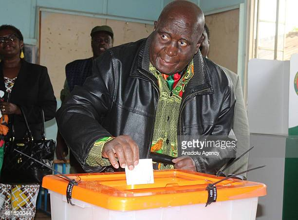Former President of Zambia Kenneth Kaunda casts his ballot for the Zambian Presidential elections at Woodland Primary School in Lusaka on January 20...