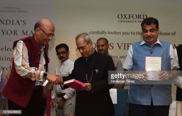 Former president Pranab Mukherjee releases the book ' India's Vibgyor Man Selected Writings and Speeches of LM Singhvi' in the presence of Nitin...