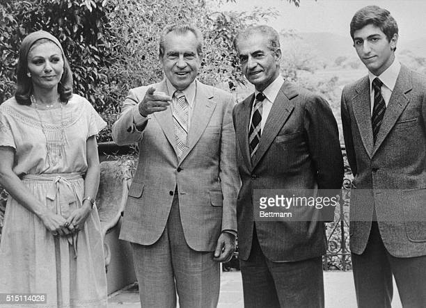 Former President Richard Nixon points to newsmen he recognizes as he finishes a one day visit with the Shah of Iran at the home where the Shah is...