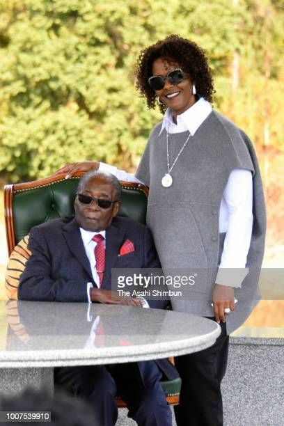 Former President Robert Mugabe and his wife Grace pose for photographs after a press conference ahead of the election on July 29 2018 in Harare...