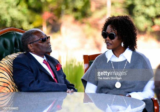 Former President Robert Mugabe and his wife Grace talk after a press conference ahead of the election on July 29 2018 in Harare Zimbabwe