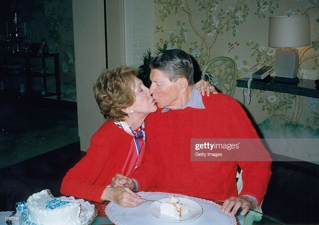 Former President Ronald Reagan gets a kiss from his wife Nancy on the occasion of his 89th birthday February 6, 2000 at their home in Bel Air, California. Reagan turns 92 on February 6, 2003.