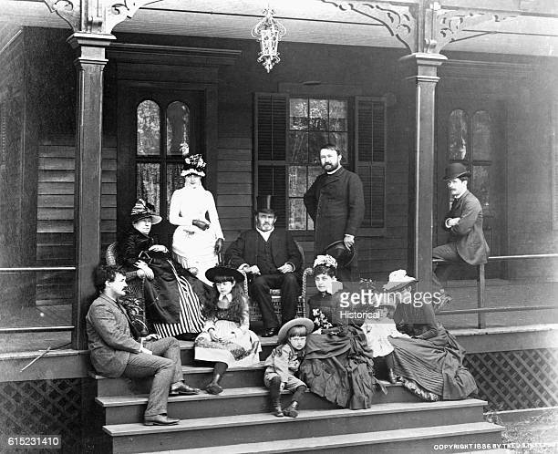 Former president Ulysses S Grant poses with his family on porch steps His wife Julia Dent Grant is seated at his right