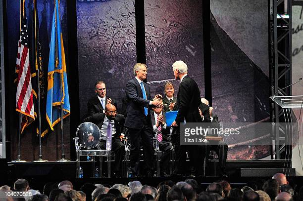 Former President William J. Clinton shakes hands with Tony Blair at the 2010 Liberty Medal Ceremony at the National Constitution Center on September...