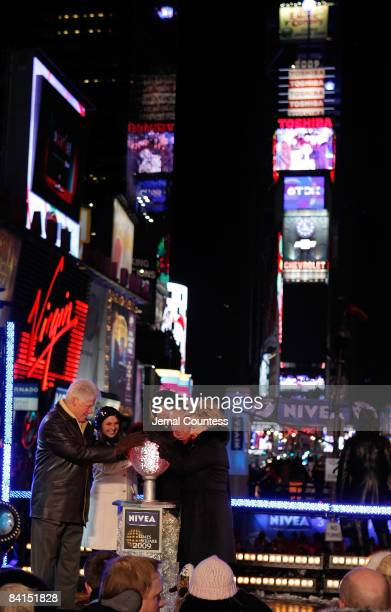 Former President William Jefferson Clinton and Secretary of State Hillary Clinton join New York Mayor Michael Bloomberg and his family as they push...