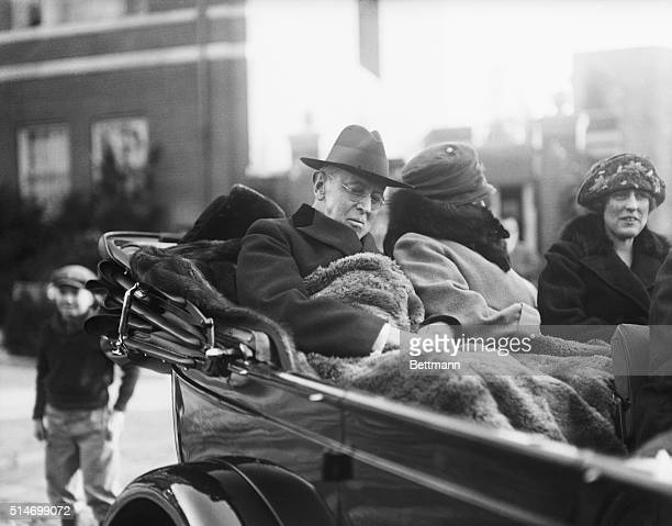 Former President Woodrow Wilson, with Mrs. Wilson and his daughter, Miss Margaret Wilson, of New York, at right in a new automobile.