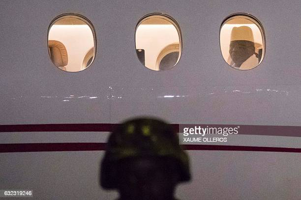 Former president Yaya Jammeh the Gambia's leader for 22 years, looks through the window from the plane as he leaves the country on 21 January 2017 in...