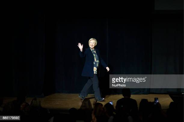 Former presidential candidate Hillary Clinton greets fans as she appears on stage during a book tour stop at the Academy of Music in Philadelphia PA...