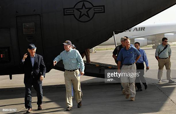 Former presidential candidate John McCain and Senator Joe Lieberman arrive at the International Security Assistance Force airport in Kabul on August...