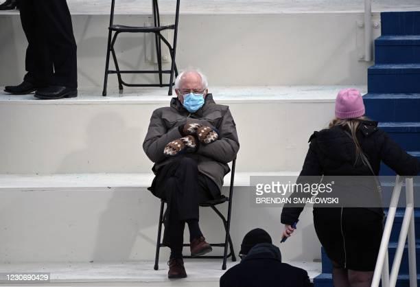 Former presidential candidate, Senator Bernie Sanders sits in the bleachers on Capitol Hill before Joe Biden is sworn in as the 46th US President on...