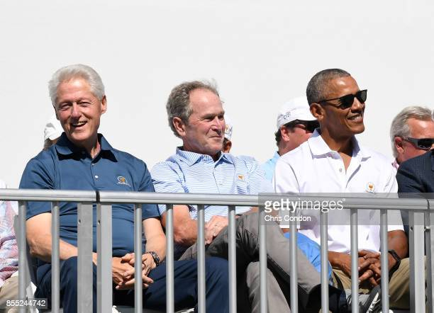 Former Presidents Bill Clinton George W Bush and Barack Obama during the trophy ceremony during the first round of the Presidents Cup at Liberty...