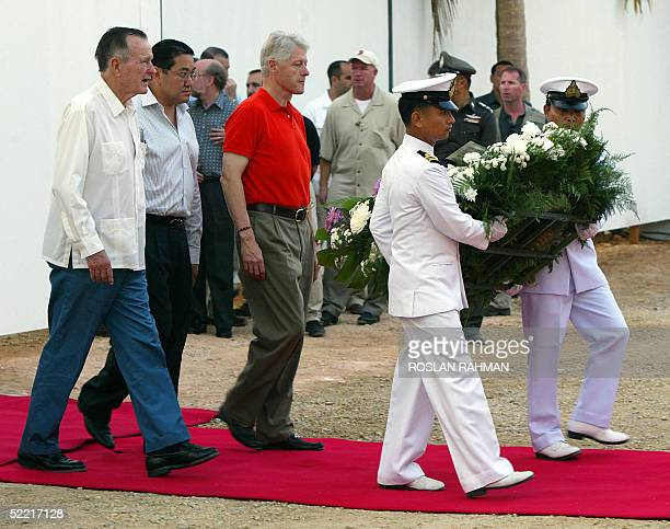 US former presidents George Bush Senior and Bill Clinton with the Thailand foreign minister Surakiat Sathirathai during a laying of wreath ceremony...