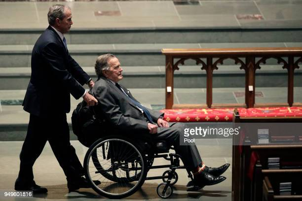 Former Presidents George W Bush left and George HW Bush arrive at St Martin's Episcopal Church for a funeral service for former first lady Barbara...