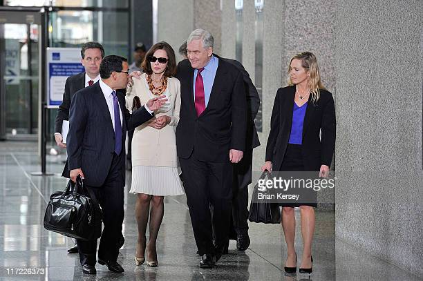 Former press magnate Conrad Black his wife Barbara Amiel and his legal team leave federal court where he was resentenced to 3 1/2 years in prison on...