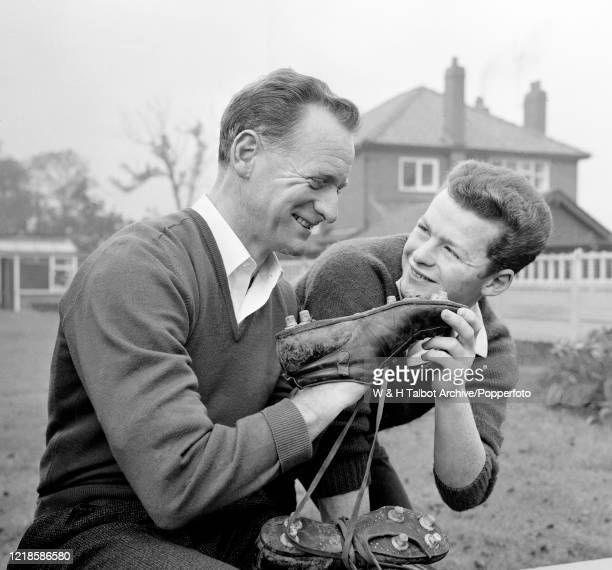 Former Preston North End footballer Tom Finney at home with his son Brian on October 6, 1963 in Preston, England.