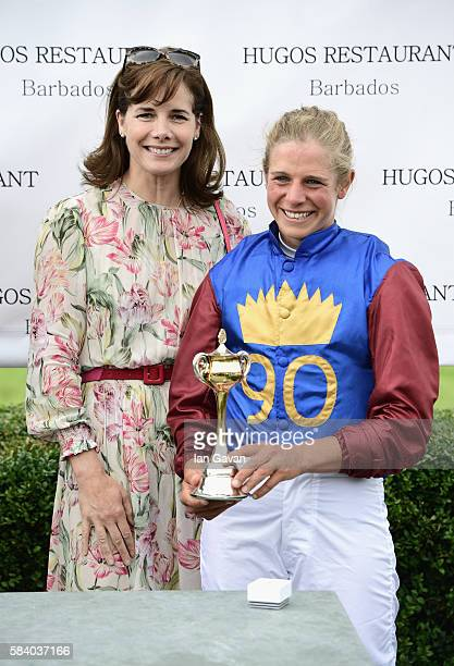 Former prima ballerina Darcey Bussel awards Isabelle Taylor the Magnolia Cup at the Qatar Goodwood Festival 2016 at Goodwood on July 28 2016 in...