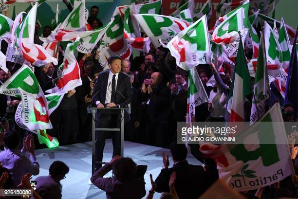 TOPSHOT Former prime minister and head of the centreleft Democratic Party Matteo Renzi waves to supporters during the last election campaign meeting...