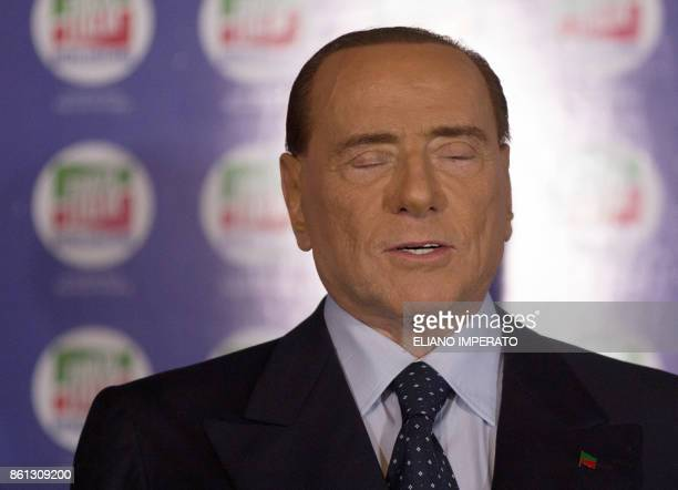 Former Prime Minister and president of Italian rightwing party Forza Italia Silvio Berlusconi sings Italian national anthem at the end of a...
