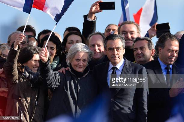 Former Prime Minister and Presidential Candidate Francois Fillon and his wife Penelope Fillon salute voters after a political meeting at Trocadero on...