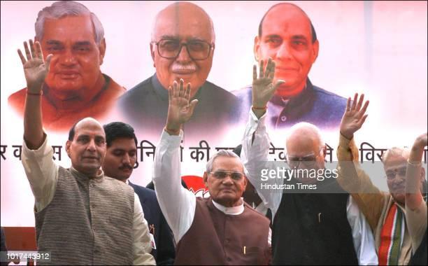 Former Prime Minister Atal Bihari Vajpayee, senior BJP leaders LK Advani, Murli Manohar Joshi and Rajnath Singh wave to party activists during a...